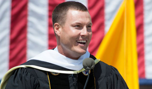 Philip Rivers, quarterback for the San Diego Chargers, addresses graduates during the 125th Annual Commencement Ceremony at CUA on May 17, 2014.